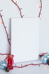 Mock up poster in interior. White canvas lean at wall. Christmas decoration.
