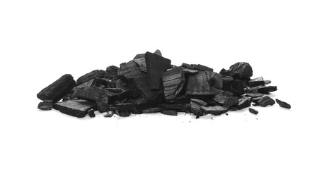 Pile black charcoal isolated on white background