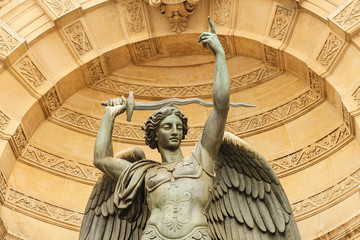 Statue of the bronze Archangel Michael keeping the sword, part of the monumental marble (26 meters by 15 meters) fountain Saint-Michel opened in 1860 during the French Second Empire, Paris, France