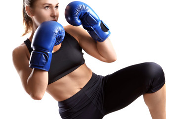 Female kickboxer on light background