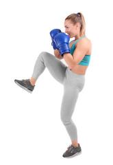 Female kickboxer on white background
