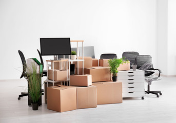 Carton boxes with stuff in empty room. Office move concept Wall mural