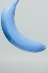 Blue banana on white background