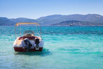 Pleasure motor boat anchored in bay