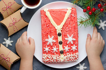 Creative Christmas cake in the form of a warm sweater for children