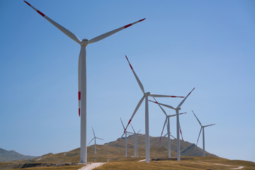 Windmills converting wind energy into electricity