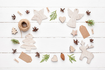 Frame of christmas wooden decorations on white background. Top view, flat lay.