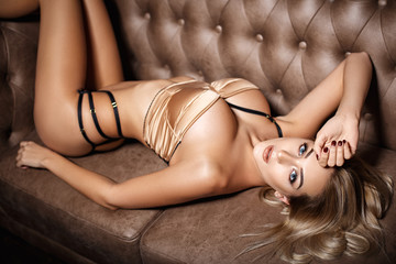 Gorgeous girl in a sexy gold lingerie