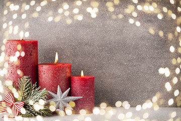 Christmas candles and lights. Christmas background.
