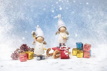 Christmas greeting card. Noel gnomes, small gifts, snow texture. Christmas symbol.