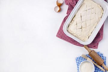 closed cake on a baking sheet, on white background