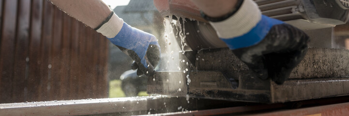 Low angle view of an angle grinder or circular saw cutting a concrete block