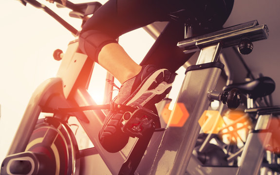Exercise bicycle cardio workout at fitness gym taking weight loss