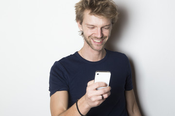 Smiling man using his mobile smartphone