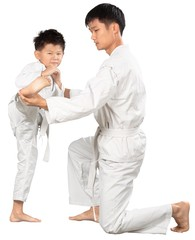 Asian Little Karate Boy and hid Teacher in White Kimono
