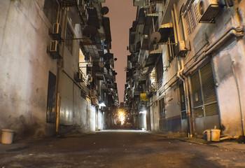 Alley in the night in Kuala Lumpur poor suburb Wall mural