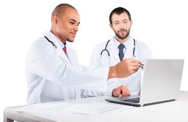Portrait of Doctors Looking at Laptop