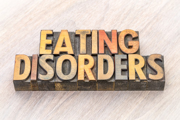 eating disorders word abstract in wood type