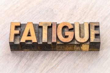 fatigue word abstract in wood type