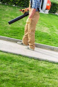 Closeup of a Gardener Using a Backpack Blower