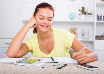 glad teenager studying