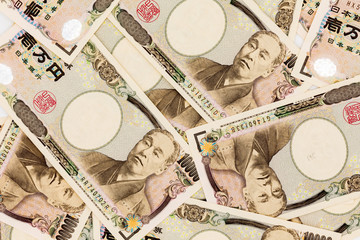 Close up of Japanese currency yen bank notes. 10,000 Japanese Yen