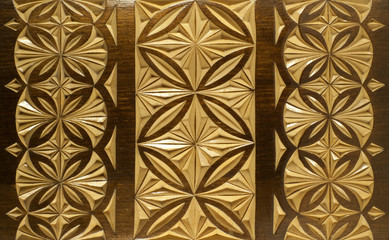 background - woodcarving (lid of carved wooden lacquered casket)..