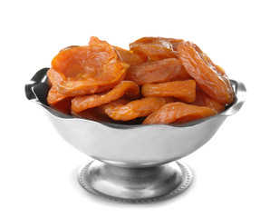 Dried apricots in bowl on white background