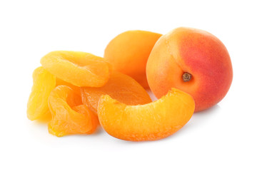 Dried and fresh apricots on white background