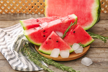 Plate with tasty sliced watermelon on table