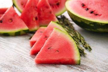 Tasty sliced watermelon on table