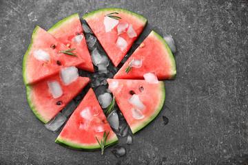 Tasty sliced watermelon on grey background