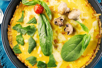 Tasty frittata with spinach, closeup