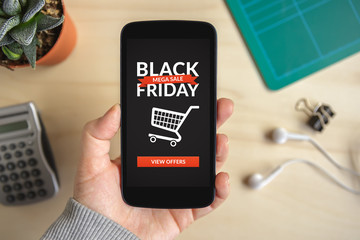 Hand holding smart phone with Black Friday concept on screen. All screen content is designed by me. Flat lay