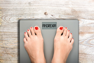 Anorexia text on weight scale, eating disorder as serious mental illness concept