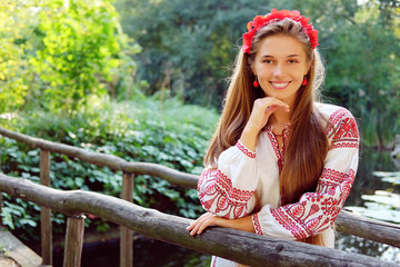 Beautiful slavonic girl with long blond hair and blue eyes with flower crown