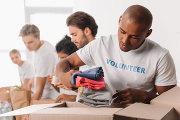 volunteer putting clothes in box