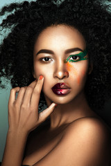 Beautiful afro woman portrait with creative make up.