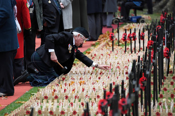 A wooden cross with a poppy is installed in the Field of Remembrance at Westminster Abbey in central London