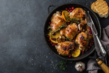 roasted  chicken with orange, cranberry and spicy herbs on pan
