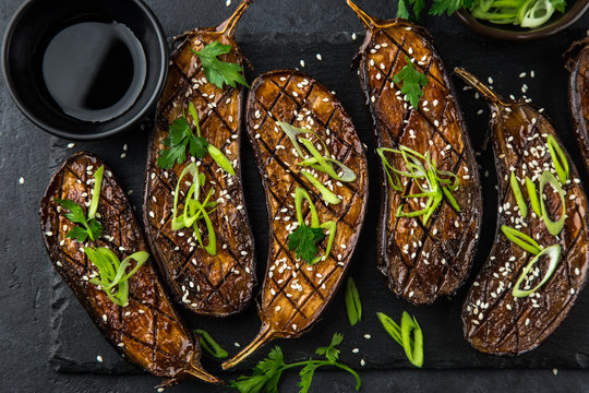 glazed grilled eggplants served with sesame seeds and green onion