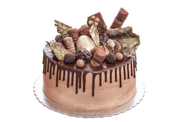 Chocolate cake with chocolates on day of birth. On a white background.