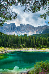 Wall Mural - Carezza lake (Lago di Carezza, Karersee) in Dolomites Alps. South Tyrol. Italy