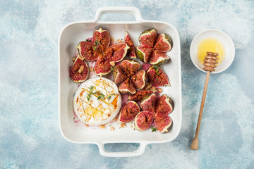 baked camembert cheese and figs with nuts and honey