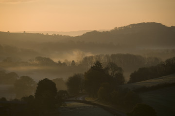 Early morning Autumn mist in the valleys in the Herefordshire countryside, England