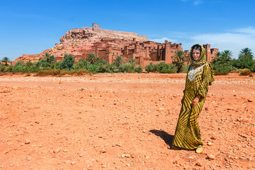 European tourist in picturesque mountain village kasbah Ait Ben Haddou not far from Ouarzazate in Morocco, Africa