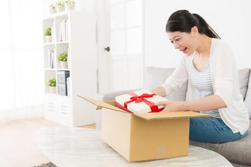 girl feeling happy when she opening parcel box