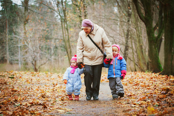 grandmother with kids walk in nature