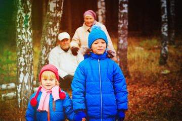 grandparents with kids walk in nature