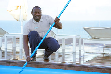 Pool cleaner during his work